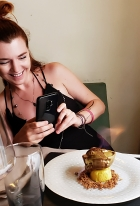 photo of taking a photo of a flaming dessert!! :)