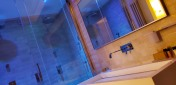 the bathroom changes colors. Color therapy! I loved taking a shower here