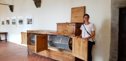 Giulia, our wine guide, with a replica of Leonardo da Vinci's flour sifting machine used by monks (I wrote down it's called Burrato)