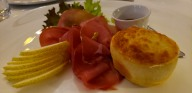 Tuscan prosciutto with pecorino cheese souffle with pears, walnuts and honey