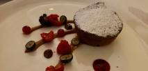 Molten chocolate cake (chocolate fondant) with hazelnut sauce